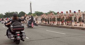 Sarah waves to Boy Scout troop as she passes them during Rolling Thunder ride