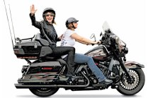 Sarah waving as she rides on motorcycle at Rolling Thunder 2011