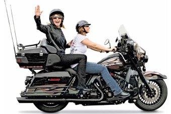 Sarah waving as she rides on motorcycle at Rolling Thunder 2011