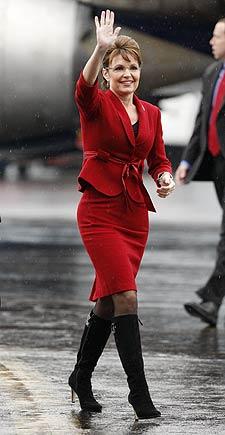 Sarah Waving in Red Suit