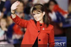 Sarah waving - red jacket with black buttons