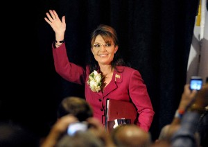 Sarah waving to crowd at Missoula Teen Challenge Event