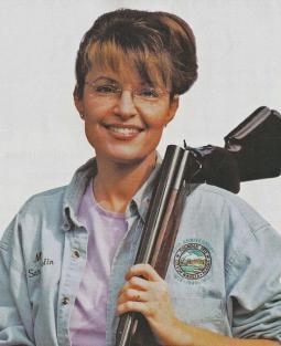 Sarah with gun on shoulder