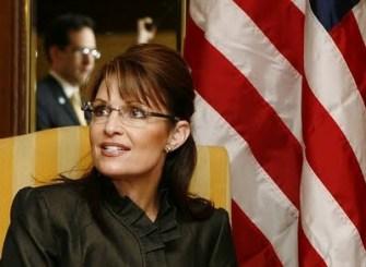 Sarah_Seated_With_Flag