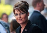SarahPalin smiling but pensive in black jacket