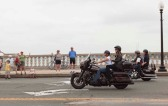 Side View of Sarah and Bristol riding on motorcycles in Rolling Thunder