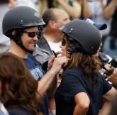 Todd adjusts Sarahs helmet at Rolling Thunder Rally in DC