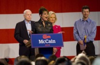 Todd and McCain with Sarah as she speaks at McCain campaign rally in Tucson 2010