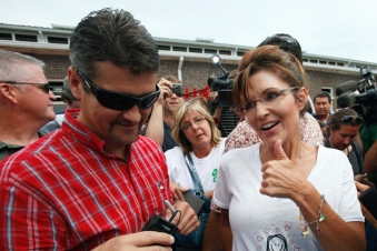 Todd holding Sharpie and Sarah giving thumbs up at Iowa State Fair