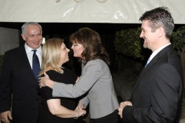 Todd looks on as Sarah greets Netanyahus