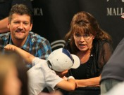 Todd looks on as Sarah talks to young boy at Bristols Mall of America book signing