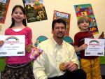 Todd posing with kids with reading certificates