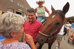 Todd talks to supporters as friendly horse butts in at Iowa Tea Party rally 2011