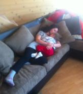 Bristol and Tripp cuddling on sofa