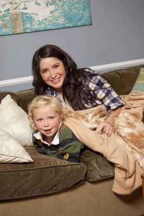 Bristol and Tripp on sofa with throw rug