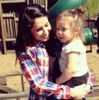 Bristol holding little girl at the park