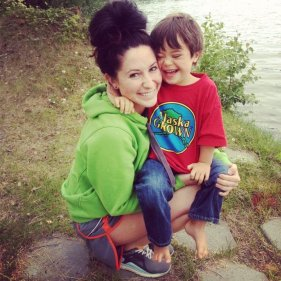 Bristol holding Tripp by the lake