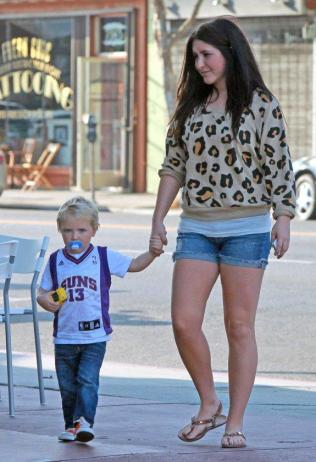 Bristol holds Tripps hand as they walk down street September 2011