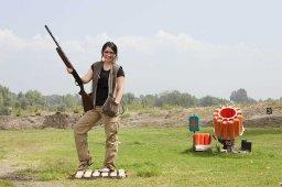 Bristol posing with gun on shooting range