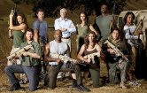 Cast of Stars Earn Stripes holding weapons