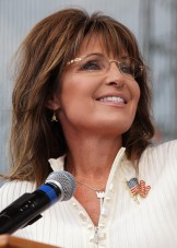 Closeup of Sarah at mike - smiling with head tilted at Iowa Tea Party rally 2011