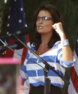 Closeup of Sarah raising clenched fist for emphasis during her speech at Kirk Adams rally
