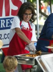 Closeup of Sarah serving BBQ at Kirk Adams rally