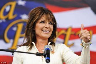 Closeup of Sarah thumbs up at mike at IA TPA rally