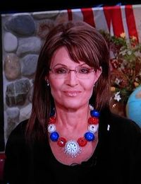 Closeup of Sarah with red white blue necklace