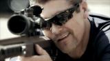 Closeup of Todd aiming military rifle