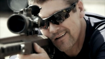 Closeup of Todd aiming military rifle