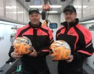 Closeup of Todd and Davis holding helmets before start of 2012 Iron Dog