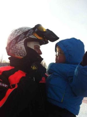 Closeup of Todd and Trig looking at each other before start of 2012 Iron Dog