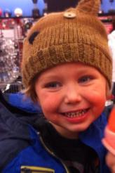 Closeup of Tripp with brown knit cap on