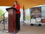 Full length side view of Sarah at podium at Tea Party rally NH