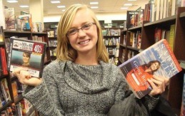 Madeleine McAulay holding copies of Going Rogue and The Undefeated