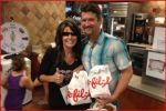 Sarah and Todd holding Chick-fil-A bags