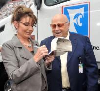 Sarah autographs cap for BMS owner Bruton Smith