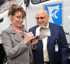 Sarah autographs cap for Bristol Motor Speedway owner