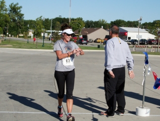 Sarah Checking Time After Marathon in Storm Lake IA