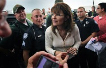 Sarah flanked by security as she talks with supporter at Iowa Tea Party 2011