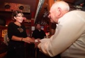 Sarah greets elderly gentleman at C4P meetup in Iowa