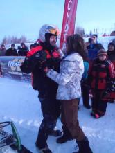 Sarah greets Todd after Iron Dog Race finish