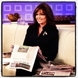 Sarah holding WSJ and smiling on TODAY Show