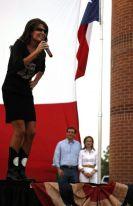 Sarah leaning forward speaking at Cruz rally in Houston