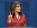 Sarah lifts finger during speech at CPAC
