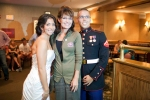 Sarah poses with newlyweds at restaurant in New Hampshire