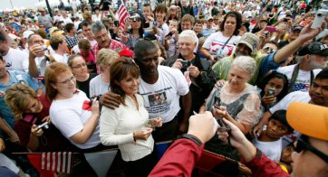 Sarah poses with young man after IA TPA rally