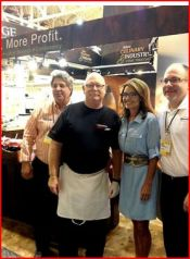 Sarah posing with bakers at New Orleans Bakers Conference