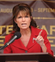Sarah raises finger with serious look on her face at Tea Party rally NH
